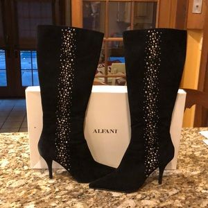 Black suede boots with embellishments